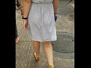 walking on the street eating dress