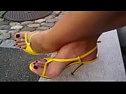 yellow high heels red nails - met her.