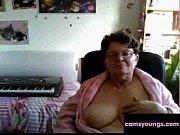 naughty granny flashing her big tits on cam:.