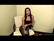 horny ladyboy is sucking dick while stroking her.