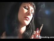 nasty brunette hoe smokes a cigarette