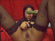 Angel asian taking cucumber