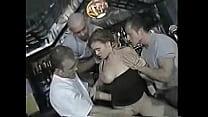 Brunette Gangbanged in Bar