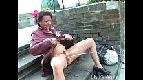 Mature exhibitionist masturbating in public and...