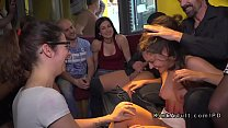 Brunette sub serving crowd in public bar
