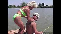 Granny Effie fucks next to a lake