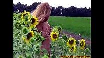 Alena posing between sunflowers