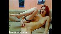 Sexy redhead finger fucks her horny pussy
