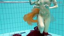 Two underwater girls loving eachother