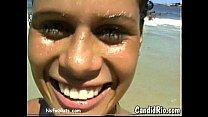 latina in bikini flashes tits at beach