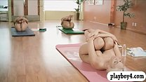Busty blonde trainer teaches yoga action with t...
