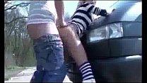 naughty girl pisses on the street