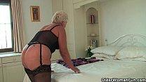 Chubby granny in black stockings masturbates