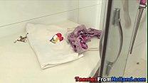 Showering teen rubs pussy