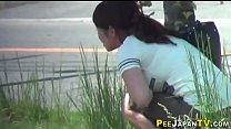Asian slut pees in public