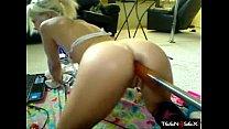 Blonde teen fucks her ass with a big dildo mech...