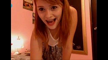 Cute teen girl with braces on webcam