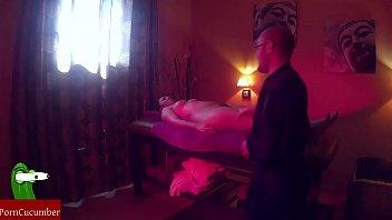 Oiled couple fucks on massage table