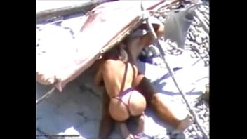 Voyeur Films Amateur Blowjob on the Beach