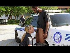 White cops suck black dick in street