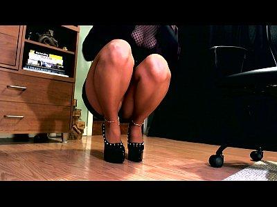 Erotic hypnotist using her high heels to mesmerize