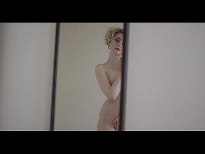 Hot wonderful blonde is masturbating passionately in bed