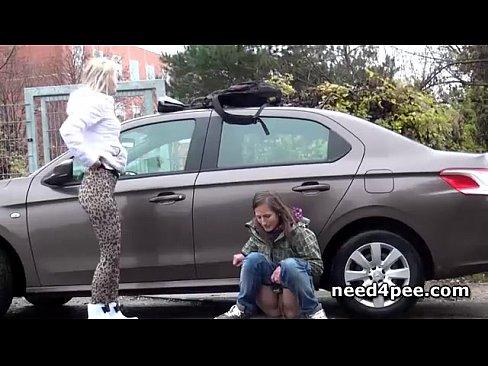 Teen girlfriends pissing behind a parked car