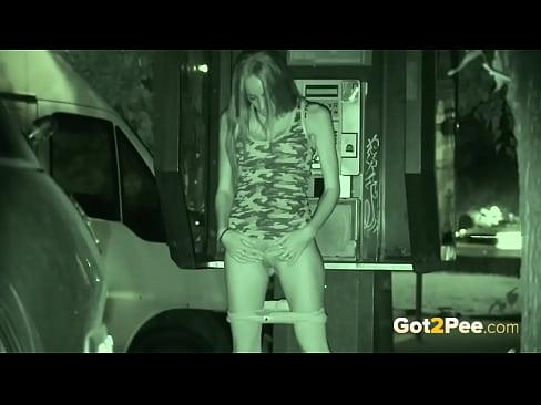 Public Pissing - A pretty European enjoys a standing pee outside