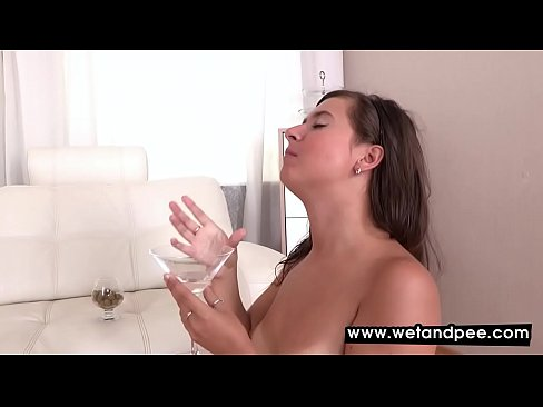 Babe moans as she pisses on herself