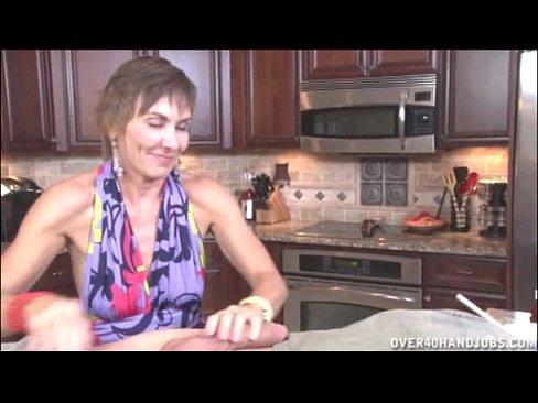 Handjob In The Kitchen