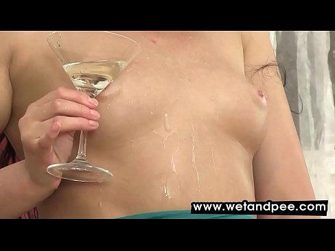 Hot brunette showering herself in warm pee