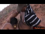 african babe takes two cocks outdoors.