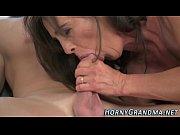 Heeled granny sucks dick