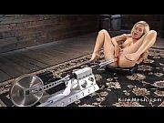 Blonde beauty fucks machine and cums