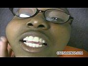 Black girl in glasses sucks white dick