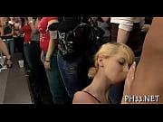 Blonde girl swallowing black 10-pounder