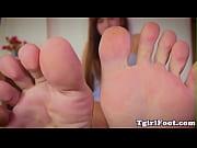 Tattooed ladyboy showing pedicured feet