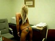 Hot blonde stripping in office