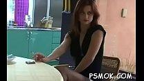 Busty bombshell enjoying a drink and a smoke whilst masturbating thumbnail