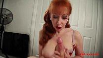 Horny big tit redhead MILF gives her man a wank Vorschaubild