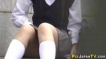 Asian student rubbing