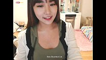 Pretty korean girl recording on camera 3
