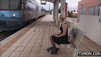 Milf masturbates on the train station