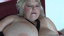 Big mature mom with huge tits fucks herself