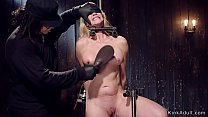 Gagged Milf in metal stock gets whipped thumb