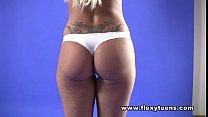 Busty blonde shows nude gymnastics