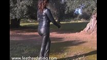Cute brunette posing in leather pants and leather jacket Vorschaubild