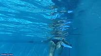Big booty milf goes for a swim