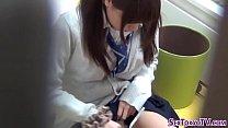 Asian cutie rubs clit