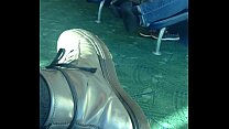 Mature man sockplay in airport terminal
